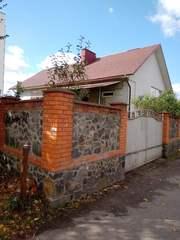Дом с участком в центре Хмельницкого